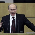 Russian Prime Minister and President-elect Vladimir Putin addresses the parliament at the Russian State Duma.
